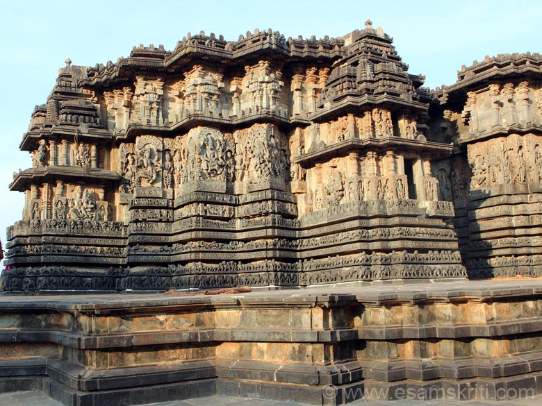 Western side of temple towards north side u see two stone chariots in pic. Note the plinth design.