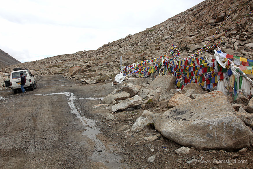 Votula Pass. Vehicle Qualis performed very well during trip. U see back of driver Nawang. He is a very good driver. At times I got nervous but his judgement was always sound. Right Buddhist flags.