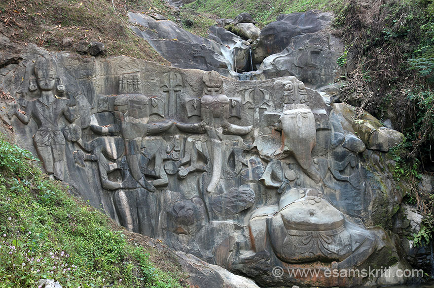 A full view of rock-cut images. Right is Ganesha, next are 2 standing images of elephant headed figure and last is Vishnu. During monsoons water falls from top as you can see. It must be a lovely sight and is like Ganeshji ka jal see abhishek ho raha hai.