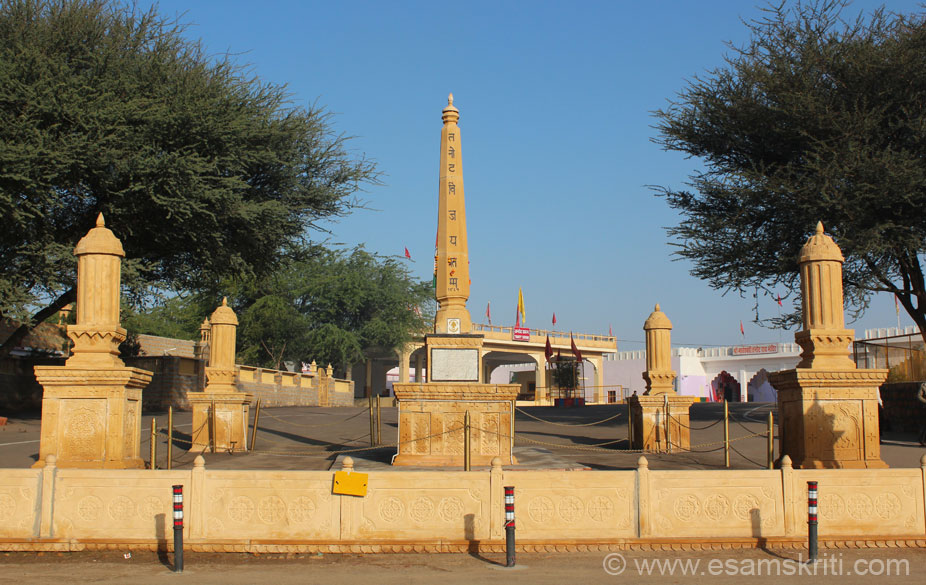 Vijay Stambh or Victory Tower at Tanot. Right side of pic white structure is the Mata Mandir or temple.  The temple was not touched during the 1965 and 1971 wars with Pakistan 