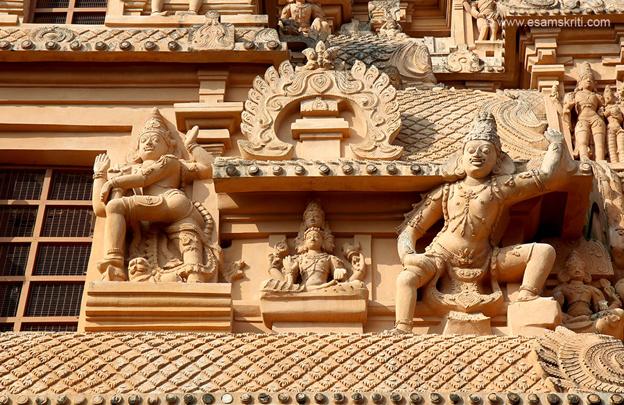 Stucco images of centre of gopuram east side. Centre 4 heads is Brahma. Central passage of gopuram has plain pilasters supported by plain brackets and on its front face bhutaganas are shown blowing conches.