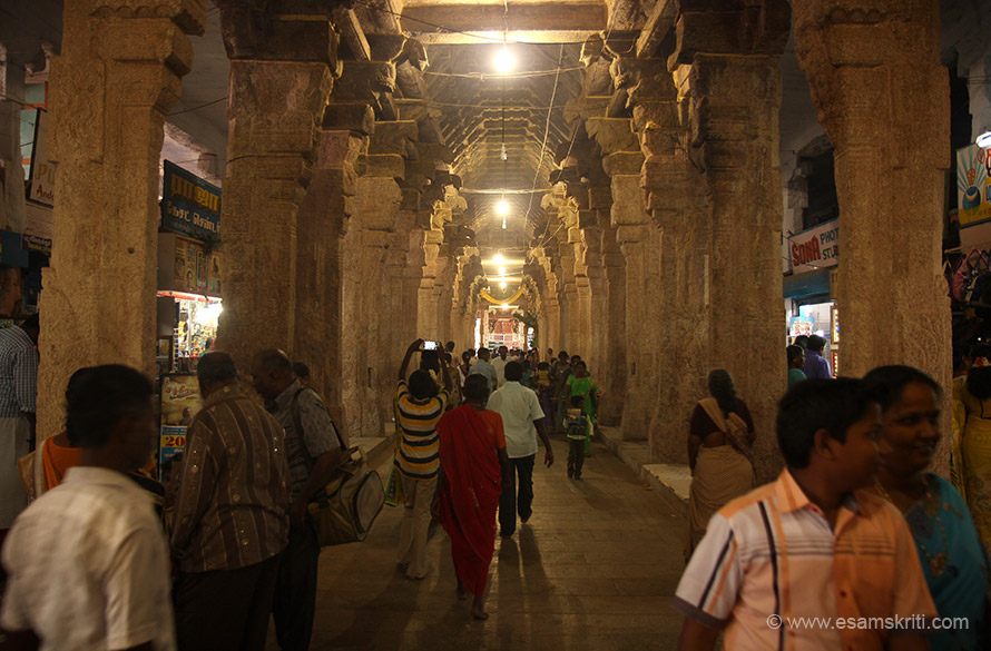 "Corridor with pillars, shops on either side towards sanctum. ""On either side of the hall, Vanamalai Jeear monastery with shops, and monasteries of Vedantha Desikar and Manavalla Saint are set up."""