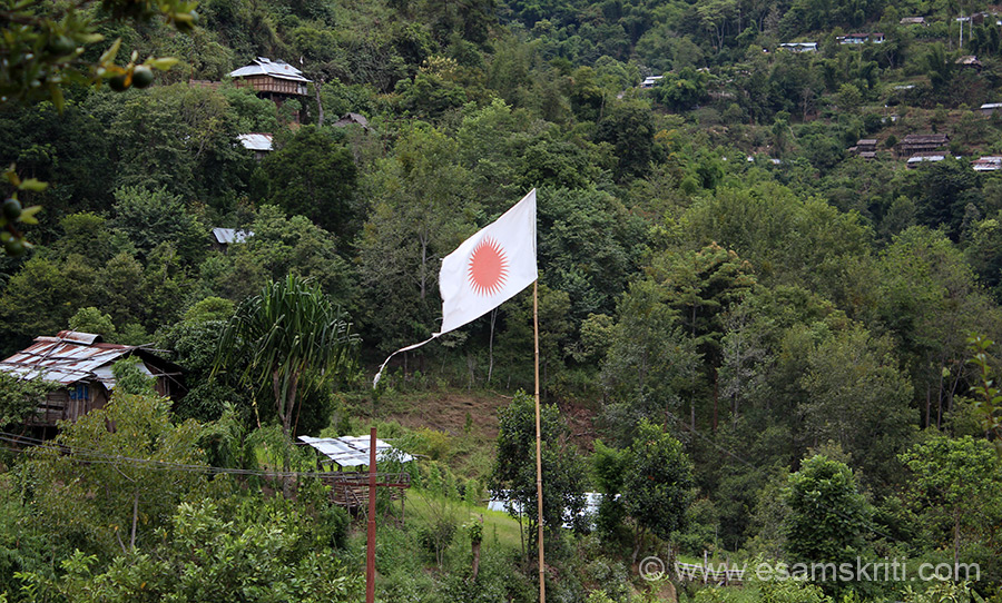 Arunachalis mostly follow the Donyi Polo religion which involves worship of the sun and the moon. Followers have this flag flying over their homes. Somewhere in between Dapurojio and Ziro.