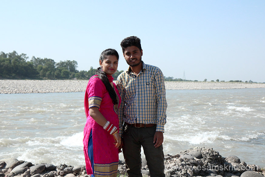 A newly wed couple on the banks of the river. Girl is wearing chudhas (red n white bangles) symbol that she is newly wed.