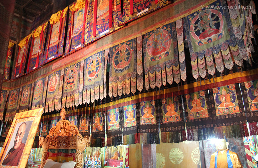 Inside hall. Pic of respected Dalai Lama on left. The chair in the foreground is where his Holiness sits when he gives teachings in the monastery. In his absence a large photo occupies the chair.