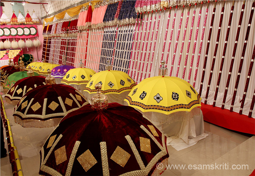 View of umbrellas on right side of hall. ``The grand show of temples in vicinity of the vast Vadakkumnathan temple was started in its present form by the great visionary, Sakthan Thampuran, the ruler of Cochin State.``