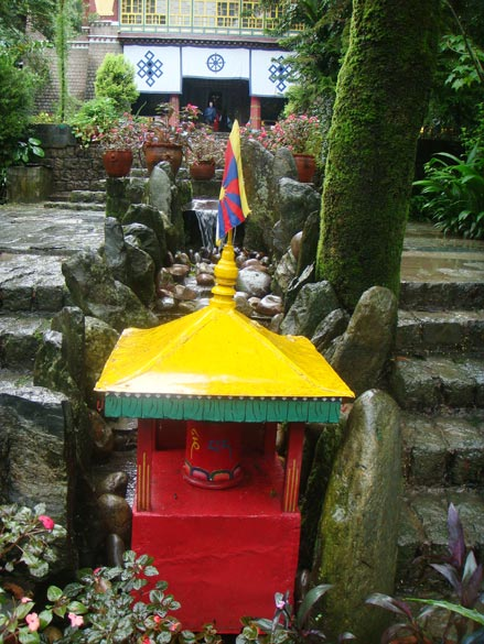 Votive stupas of tiny choertens dot the beautiful compound of the Norbulingka monastery.