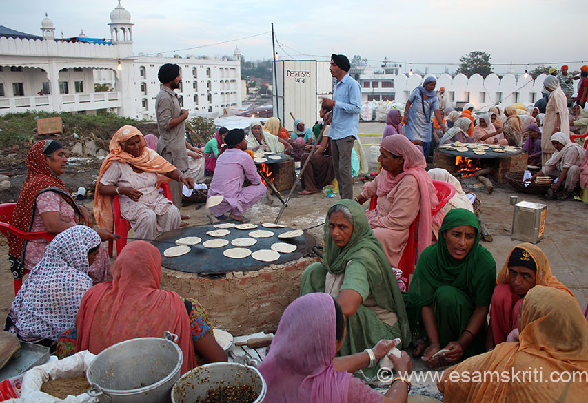 Ladies making chapatis at the langar in Keshgarh Sahib. By one estimate there were atleast 500 langars during Hola Mohalla. Food is made by devotees and served free of cost. In Khalsa,