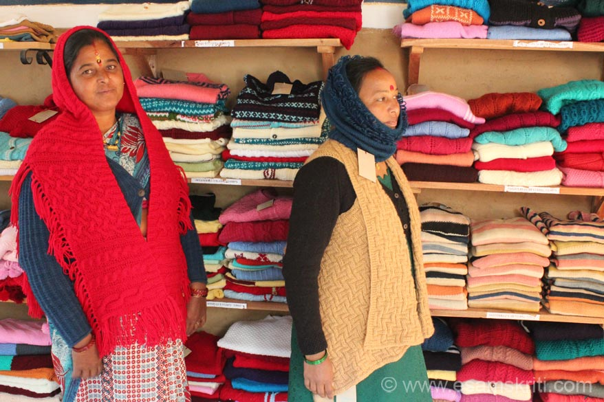 Another display pic of UMANG products. Left is Red PONCHU that covers head and body. Right head is Sunflower cap which covers head and neck while below is waist coat. Their 