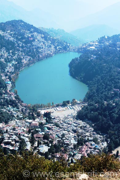 Walk for about 5-7 minutes to the top of the hill. There is a bench to sit, be careful one slip and u go straight down. Horse shoe shaped Naini Lake. Most of the hotels on left side of lake.