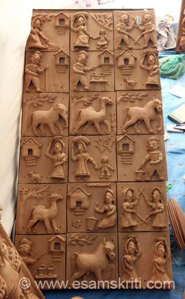 Terracota work by Padma Shri Shilp Guru Mohanlal Kumhar. He is a trainer and manufacturer of terracotta, sculpture, images of God and Goddess, Panel, Wall Tiles etc. Mohanlalji is based in Hanuman Pura, Village Motela, Teh Khamnor, Dist Rajsamand Rajasthan. Loved his work, could not get my eyes off it.