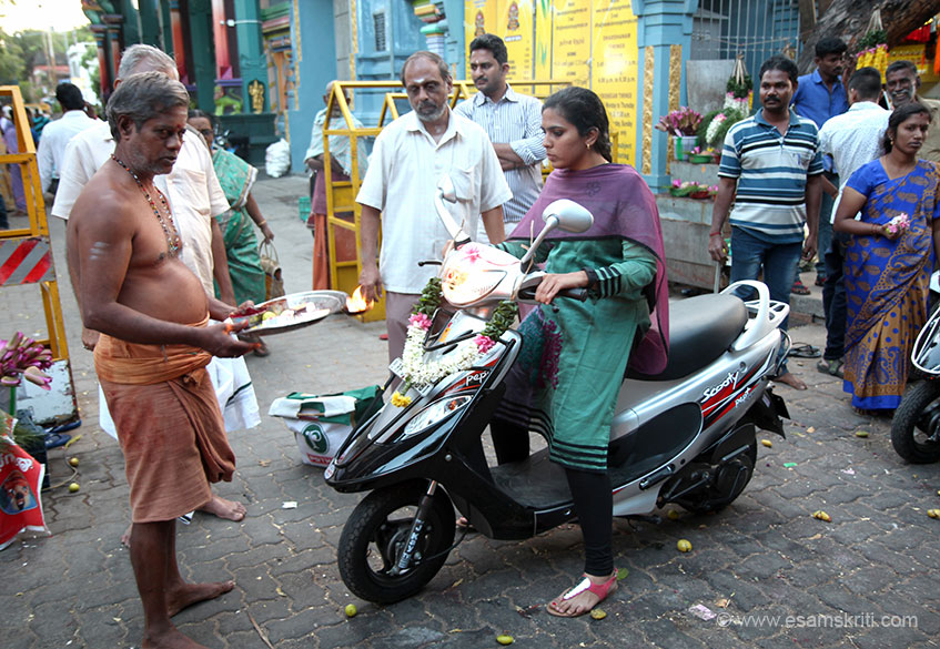 There was a line of devotees with new vehicles who come to get blessings of Lord Ganesha. Note a limbo or lemon is placed on the street over which the new vehicle drives over.
