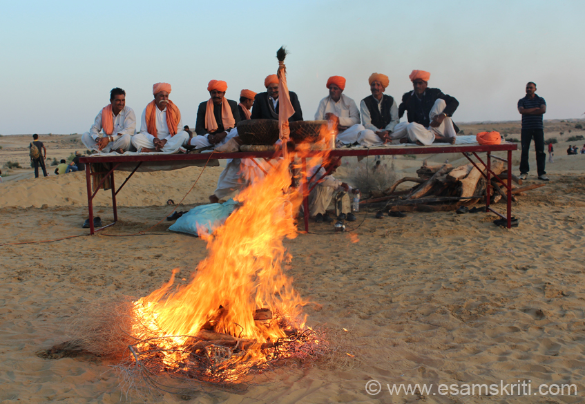 Wood is being burnt for the Fire Dance. After wood is burnt men of this group from Bikaner (Banjara community) actually walk on the fire. Group of men behind are the musicians. This 