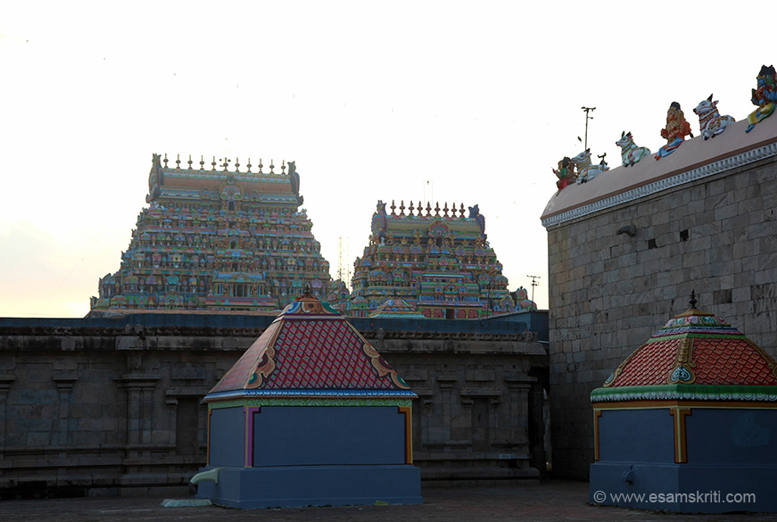 "Right is main temple wall. Two more gopurams one of which is main entrance facing the east. ""The temple is huge. It has 9 Rajagopuras, 80 vimanas, 12 tall walls, 13 mandaps, 15 wells of of Theertha importance, 3 gardens, 3 prakaras, 365 Shiva Lingas representing the days of the year, shrines numbering above 100, 86 Vinayaka idols and temples within the temple numbering above 24."""