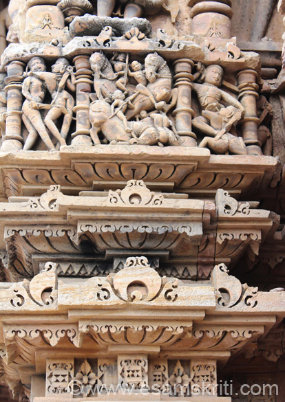 Another pic of wall sculptures. Left to right is mithuna couple, centre seems a war scene, right is again a fight. Person standing has sword in hand. All temples show the influence of the 