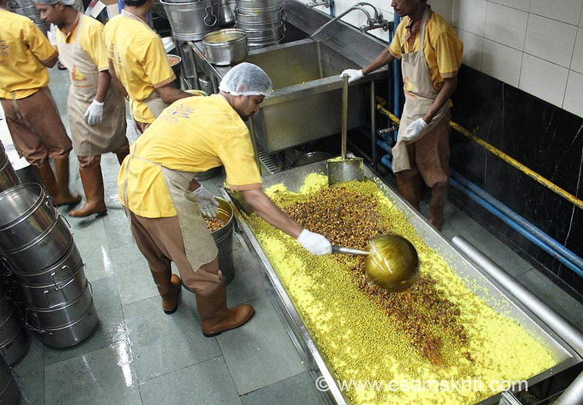 Once rice pours into the tray vegetables are added as you see, idea is to make the food more nutritious. All data is with reference to what happens in Mumbai where this kitchen is located. Govt gives 100 gms of grain (rice) for primary school child and 150 gms for secondary school child. Rice received from Government goes through a elaborate cleaning process which you shall see later. Against a actual cost of Rs 5-6, the foundation receives cooking charges of Rs 3.02 per meal for primary section.