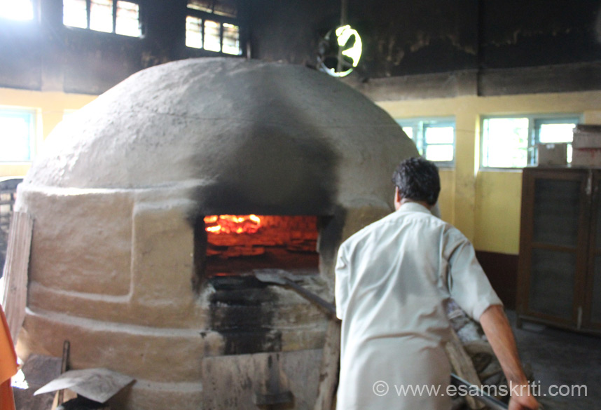 This is the oven. Bread is places on trays and then placed inside the oven by the person whom you see. They bake their own bread as well.