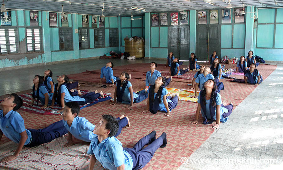 Students at a Art of Living class - doing Surya Namaskar.