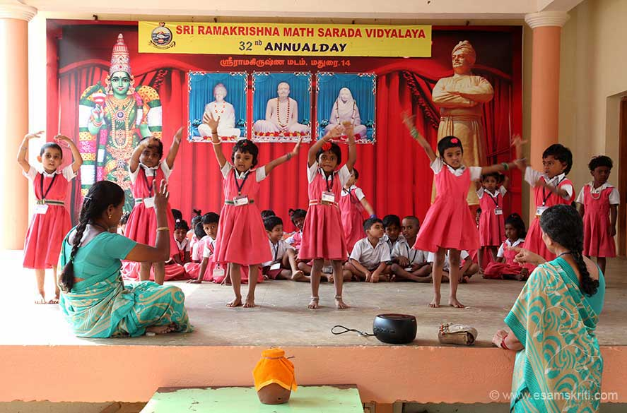 Children doing rehearsals for annual day function. The centre runs a free Tuition Centre. Teaching is free, so are books and note-books. It is in the form of extra