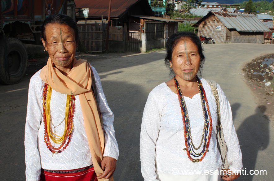 On reaching the main road we saw these two ladies who were returning from the Church. They belong to the Apatani tribe. Women are well known for facial tattoos and nose plugs. This