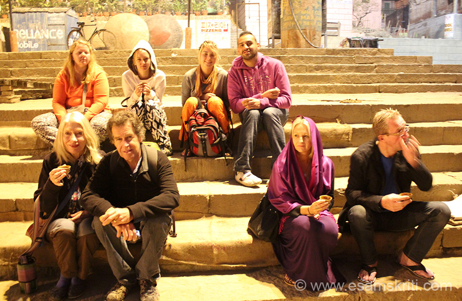A group of foreigners enjoying chai in kullads (glasses made of clay). Tea in a kullad tastes much better than in a plastic glass.