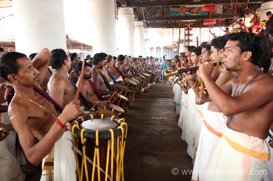 Music is called Chenda Melam or Percussion Rhythm. Instrument on left is called MADDHALAM, on right in mouth is KUZHAL (like the shehnai). ``In 1971, the Government of Kerala, through a special order, took over the administration of the Temple.``