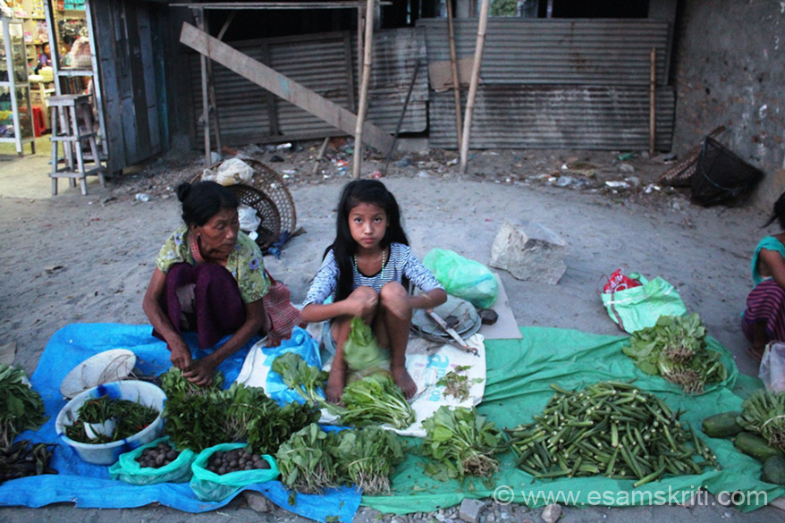 Christian girls selling vegetables in Dapurojio. Reasons for conversion are many. One is lure of money. Two is lack of adequate medical facilities. A convert told me that as per local tradition when a ghost goes in a person body and when local priest unable to remove it, then Christian prayer removes it. It is the starting point to conversion. However, converts upset with the Church demands for donations/contributions on an ongoing basis.