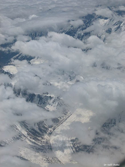 An aerial view of a Himalayan glacier. A glacier is a large persistent body of ice that forms where the accumulation of snow exceeds its ablation (melting and sublimation) over many years, often centuries. At least 0.1 km2 in area and 50 m thick, but often much larger, a glacier slowly deforms and flows due to stresses induced by its weight.
