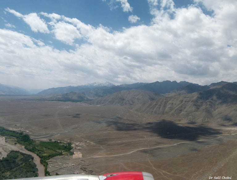 """Barren expanses and ranges around Leh. Ladakh is a high altitude plateau, in the rain shadow formed by the Great Himalayan Range. There is no rainfall, all the snow is due to condensation of the atmospheric water vapor. The rivers & its tributaries are dry in winter. Melting of snow in summer causes floods and landslides.