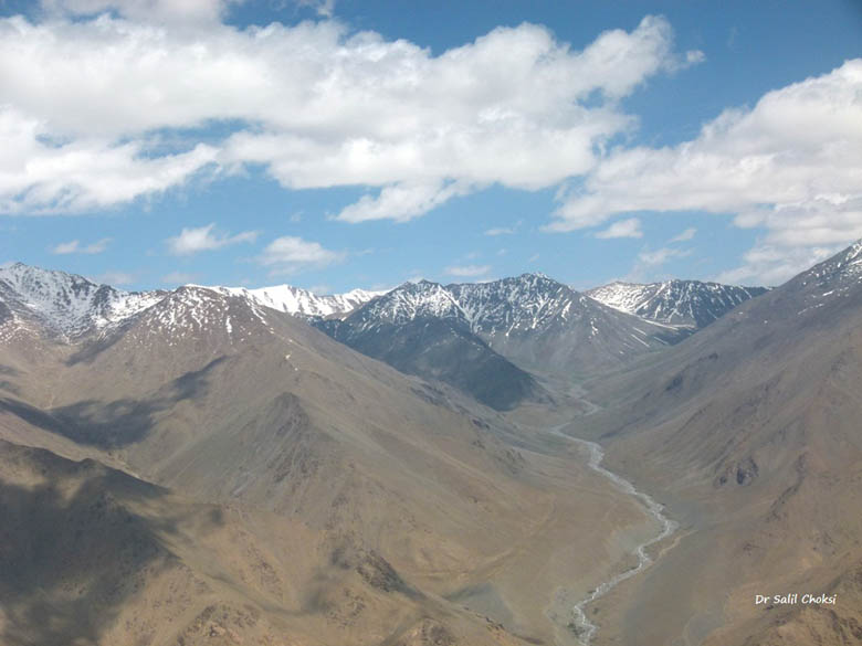This picture shows the Ladakh mountain range and a tributary of the river Indus , as seen from an aircraft after takeoff from Leh airport.