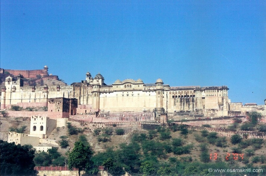 A view of the Amber Fort (11 kms from Jaipur). Amber is the ancient capital of Jaipur state. Construction of the fort palace began in 1592 by Maharaja Man Singh. It was later completed by Jai Singh before he moved to Jaipur in the plains below. The fort is built in red sandstone & white marble. It has interesting apartments the likes of which are found only in Jaipur. An imposing stairway leads to the Diwan-I-Am or Hall of Public Audiences. Painted scenes of war adorn the walls of the Fort with precious stones & mirror set into the plaster.