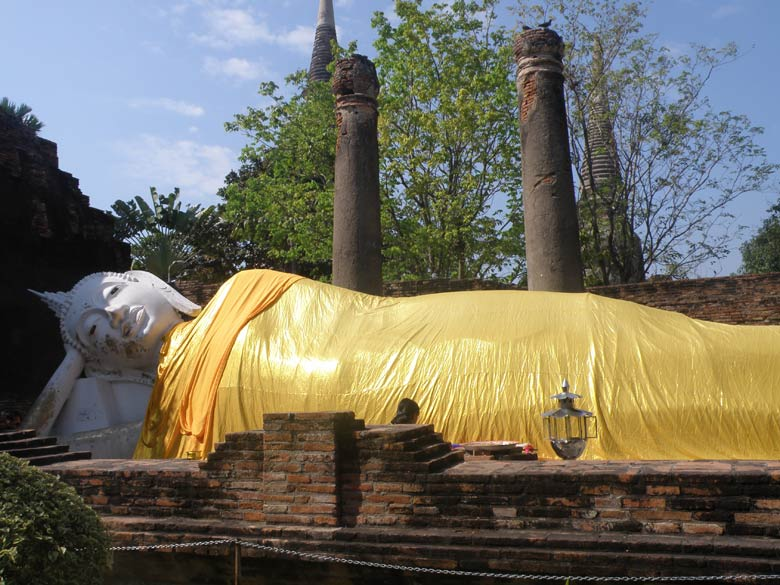 Ayutthaya is about 1.5 hour bus drive from Bangkok. Take Sky train to Mo Chit terminus and than walk down to the Bus Station OR take a taxi from Bangkok. I hired a tuk-tuk for 750 Baht to take me round (overpaid). You see the famous reclining Buddha in Wat Yai Chaimongkon in saffron robes. If you wish to click pictures reach Ayutthaya by 7.30am, it gets too sunny after that.