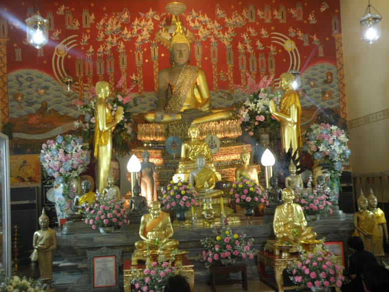 A picture of Buddha images inside the hall.