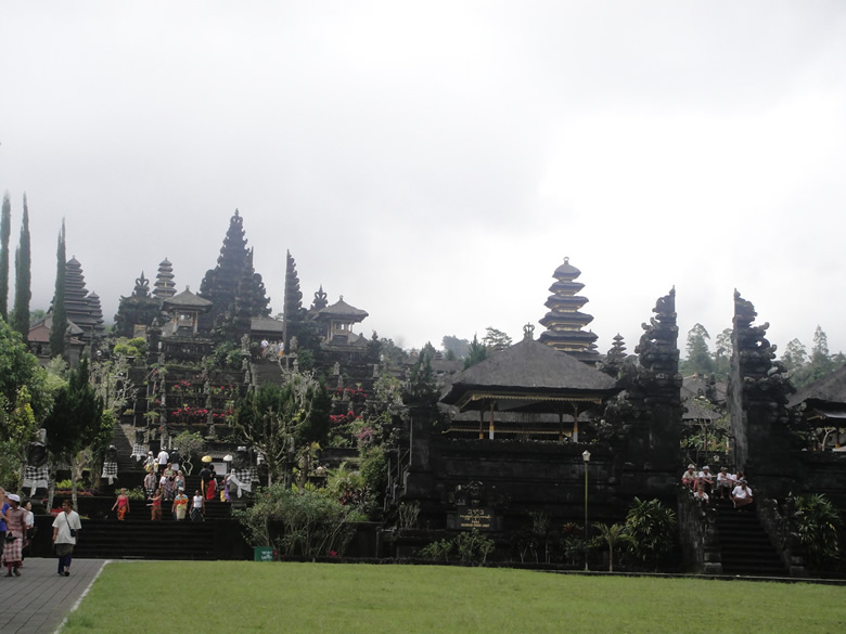 The sanctuary of Besakih on the slopes of Gunung Agung (Mount Holy) is over a thousand years old and is known as the Mother Temple of Bali, the biggest and holiest of all Balinese temples. Steps rise through split gates to the main courtyard where the Trinity shrines are. Around them, stand eighteen separate sanctuaries, belonging to different regencies and castes.