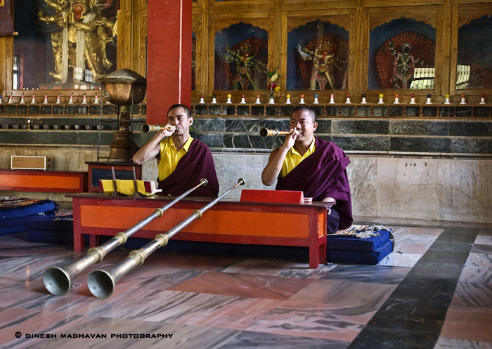 Monks using their instruments during their prayer session.