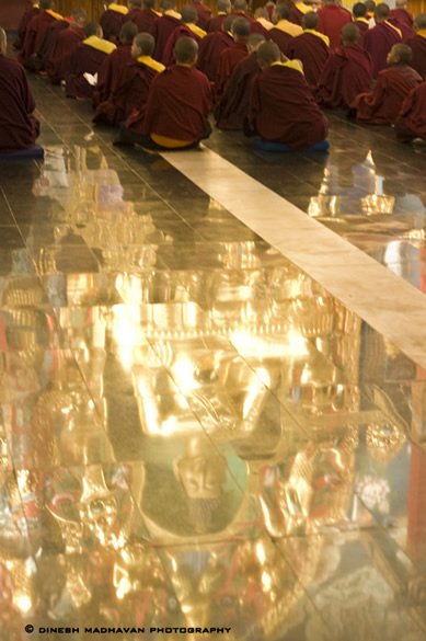 A reflection of the gold statute on the floor.