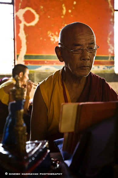 A senior monk going through one his daily routine.