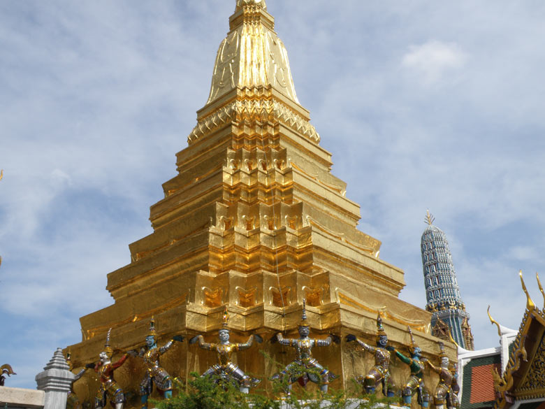A close up view of the Chedi (stupa). Behind that is `prang` (a elongated cone shaped tower).