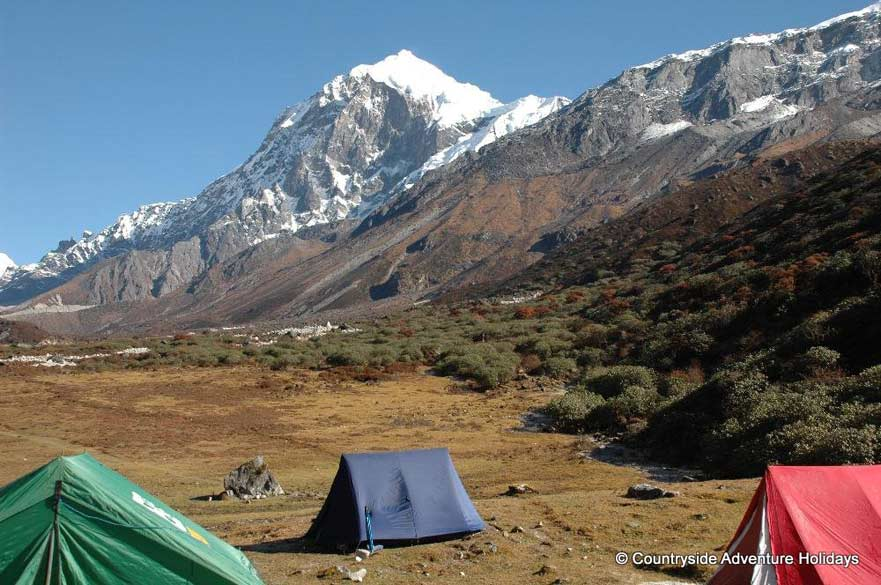 Camp site at Thanshing Kham. In background is Mount Pandim.