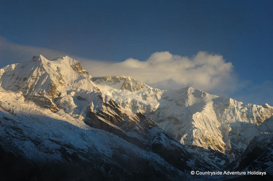 The purpose of the Goecha-la trek is to get as close to the Kanchenjunga as a ordinary person can. You see the Kanchenjunga peak 28,168 feet. Photo taken from View Point. The base camp is still ahead.