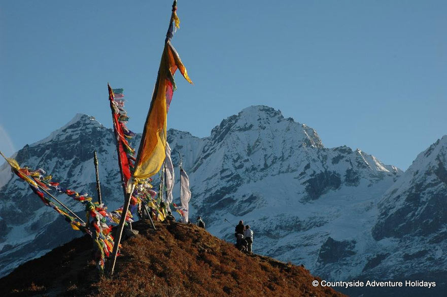 U see prayer flags with Mount Thanshing Khang.