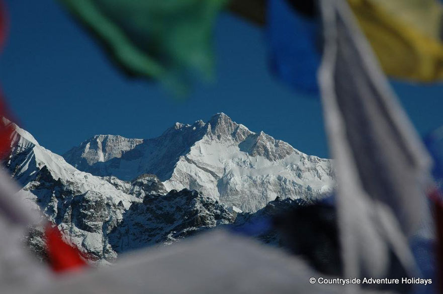 Seen thru the gaps between prayer flags in Kanchenjunga.
