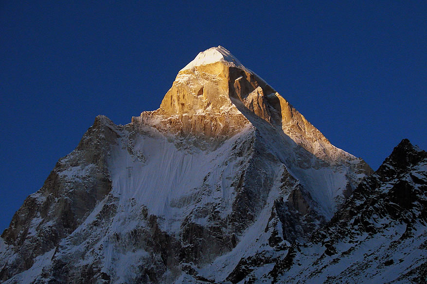 Early morning sun rays on the Shivling. From Tapovan u can see Shivling (6,540 metres), Kedar Dome (6,808 metres) and Mount Meru (6,507 metres).