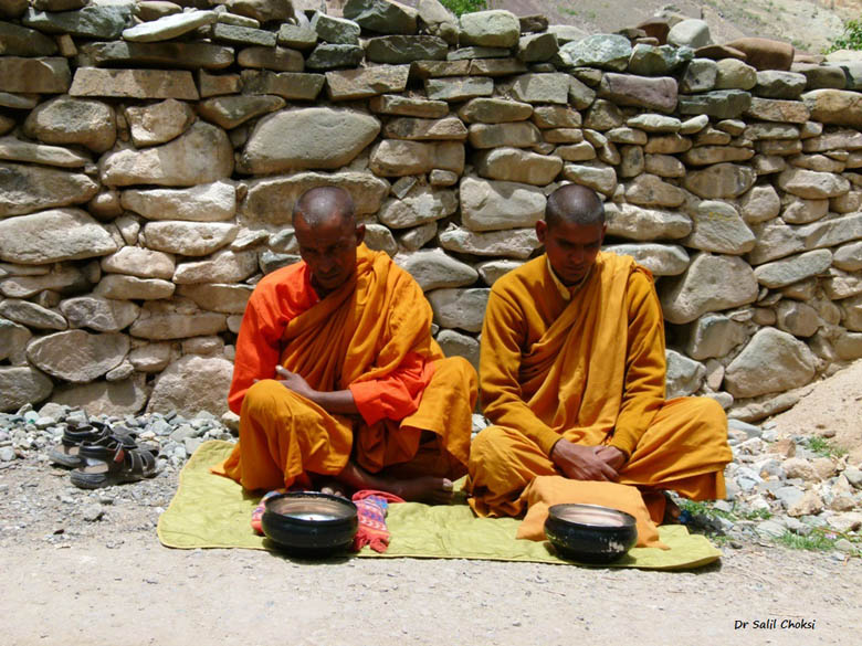 Blind mendicant monks, singing soulful hymms in return for alms.