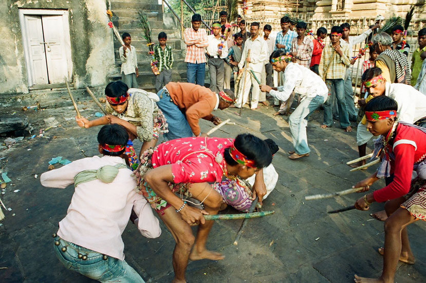After darshan at temple they come out and dance with sticks. Not a Dandiya like in Gujarat but something unique. Dance with lots of fervor and energy. They wear colorful shorts as you see.