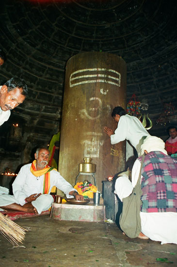 You see the 8 feet high lingam in the temple.