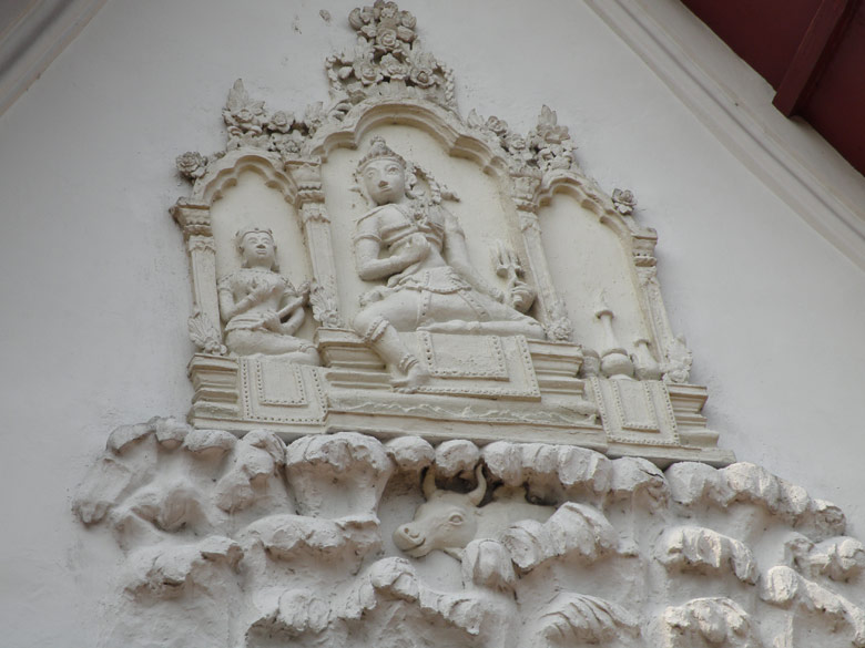 Pediment showing the residence of Shiva. This was on the wall of the building that houses the Shiva shrine. The cow that you see below is Nandi.