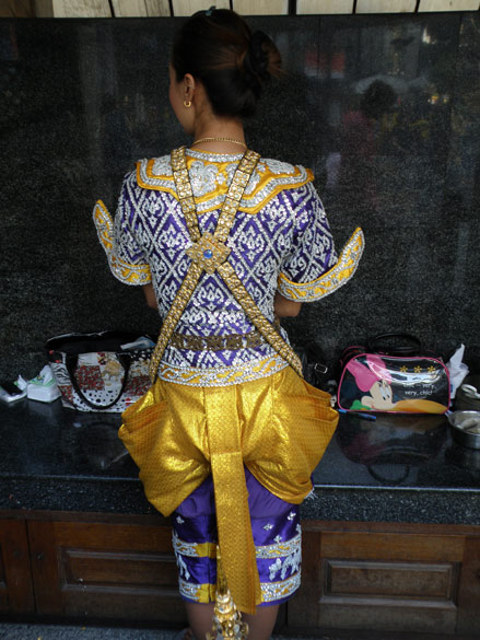 In the Erawan shrine, you can on payment, have a number of Thai girls perform local Thai dance and pray to Lord Brahma for you. What impressed was their dress. The girls wore a cloth round the waist that resembled a Dhoti and short decorated pants up to the knees. It took some effort to get this girl to let me click her back side - had to explain that I was only interested in the Dhoti look.