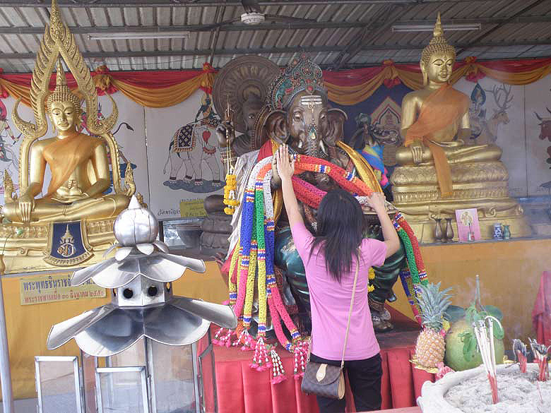 You see an image of Lord Ganesh outside Wat Phanancherng, Ayutthaya. This Wat has the oldest large cast bronze Buddha image in Ahutthaya. You see a Thai girl worshipping the Lord before entering the Wat.