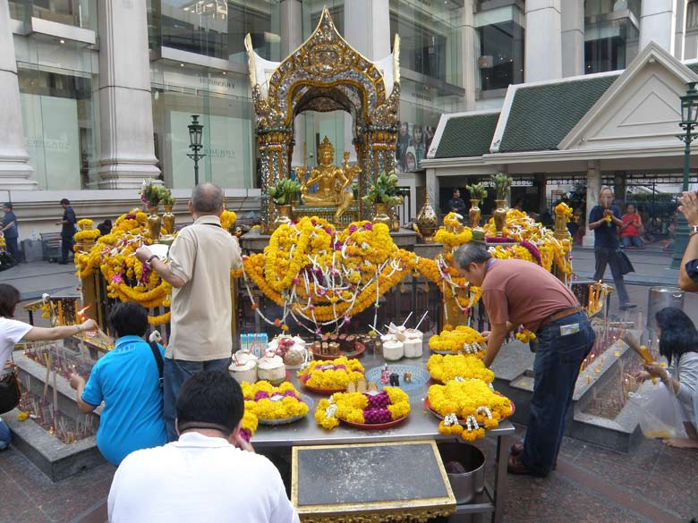 Erawan shrine ie close to Central World, Chidlam station. It is a Lord Brahma shrine. Board says it is Thao Maha Brahma.Thai Buddhist tradition associates Lord Brahma with creation. You see overview of temple. It is at a street corner and attracts lots of devotees. I saw many Thais and met some Chinese/Indonesian tourist as well.